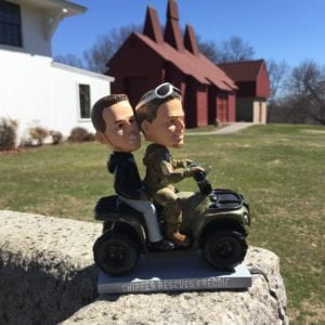 Army Colored ATV Which Is Camouflage As Well Freddie Straight Pimping On Back Holding Tight And Extremely Thankful His Buddy Came To Rescue Him